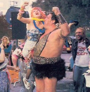 """A fury skirt-wearing Andre The Giant appears in a puff of pink smoke and proceeds to punch everyone in the face in Cyndi Lauper's """"Goonies R Good Enough"""" music video."""
