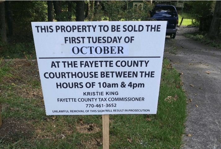 The foreclosure sign outside of Paul Orndorff's home