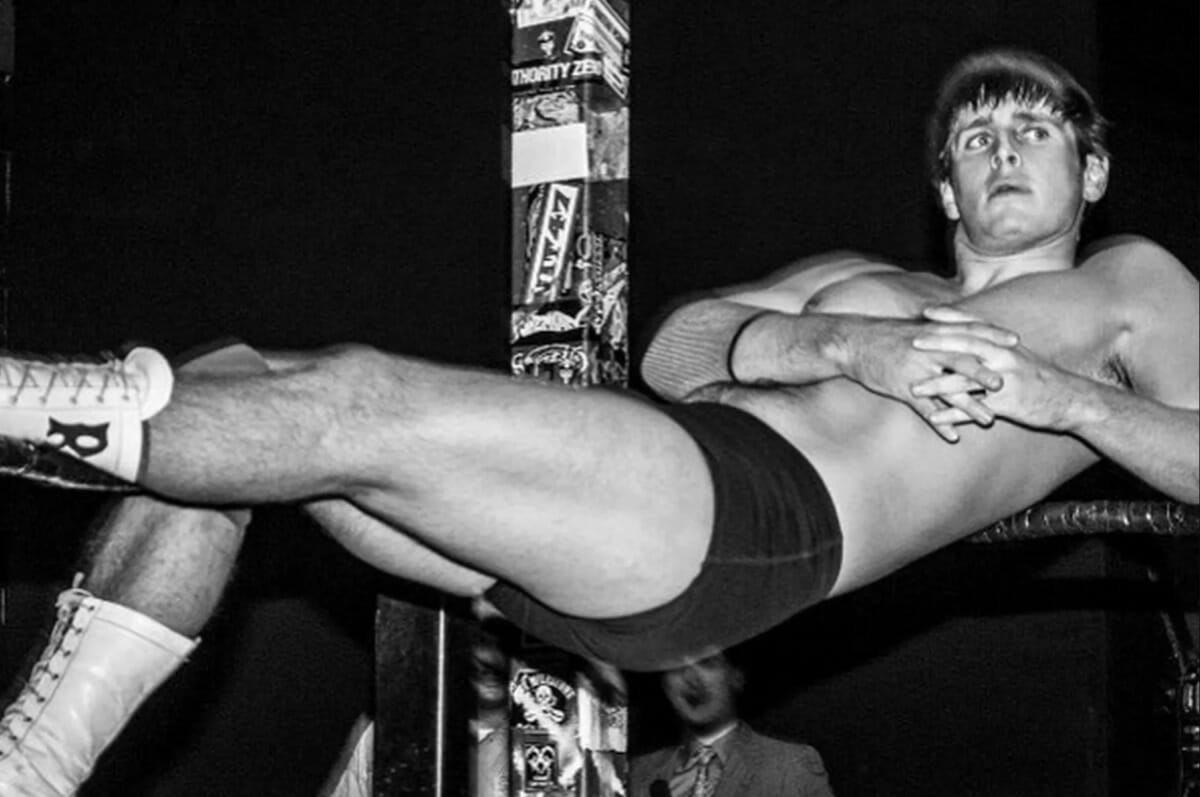 Black and white photo of Reid Flair resting against the ring ropes