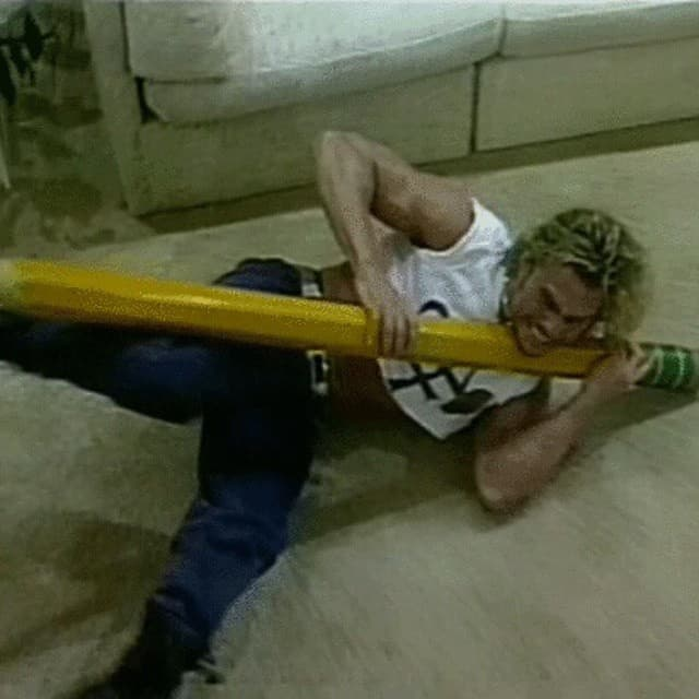 Brian Pillman wrestles a pencil in reference to the bookers ('the men with pencils') on ECW television