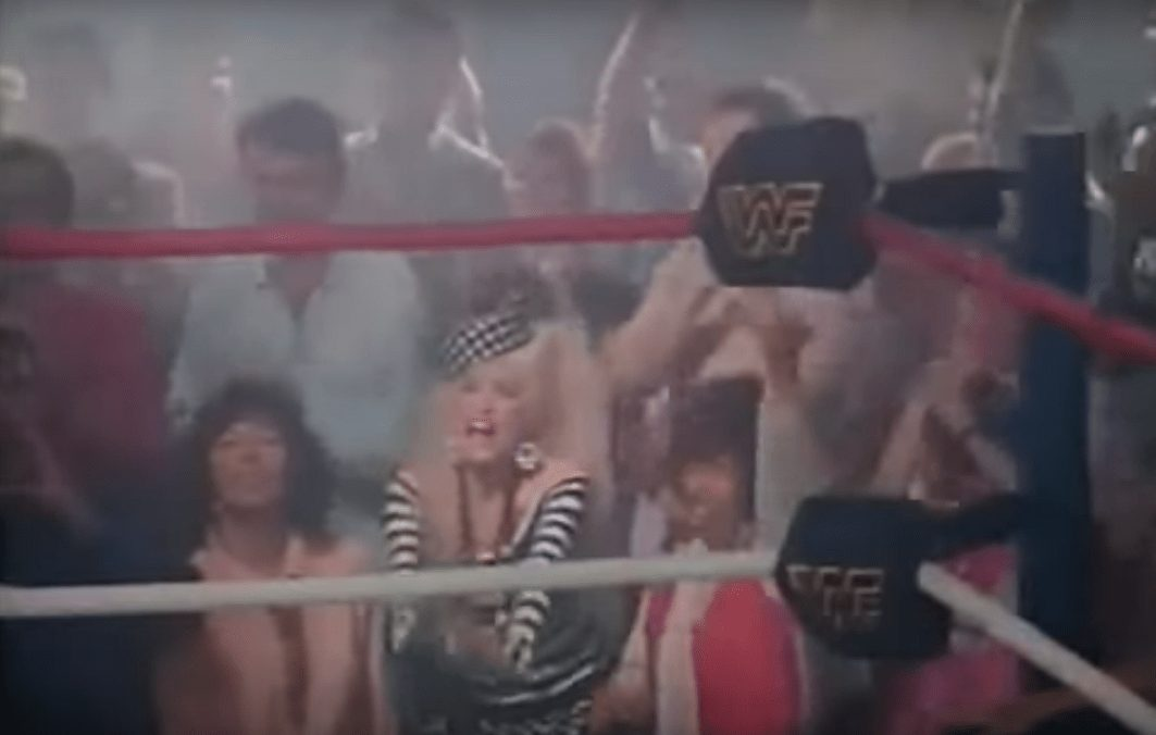 """Wrestler cameos in music videos - Dolly Parton screams """"STAR LIGHT STAR BRIGHT"""" from the crowd to Hulk Hogan in her 'Headlock On My Heart' music video"""