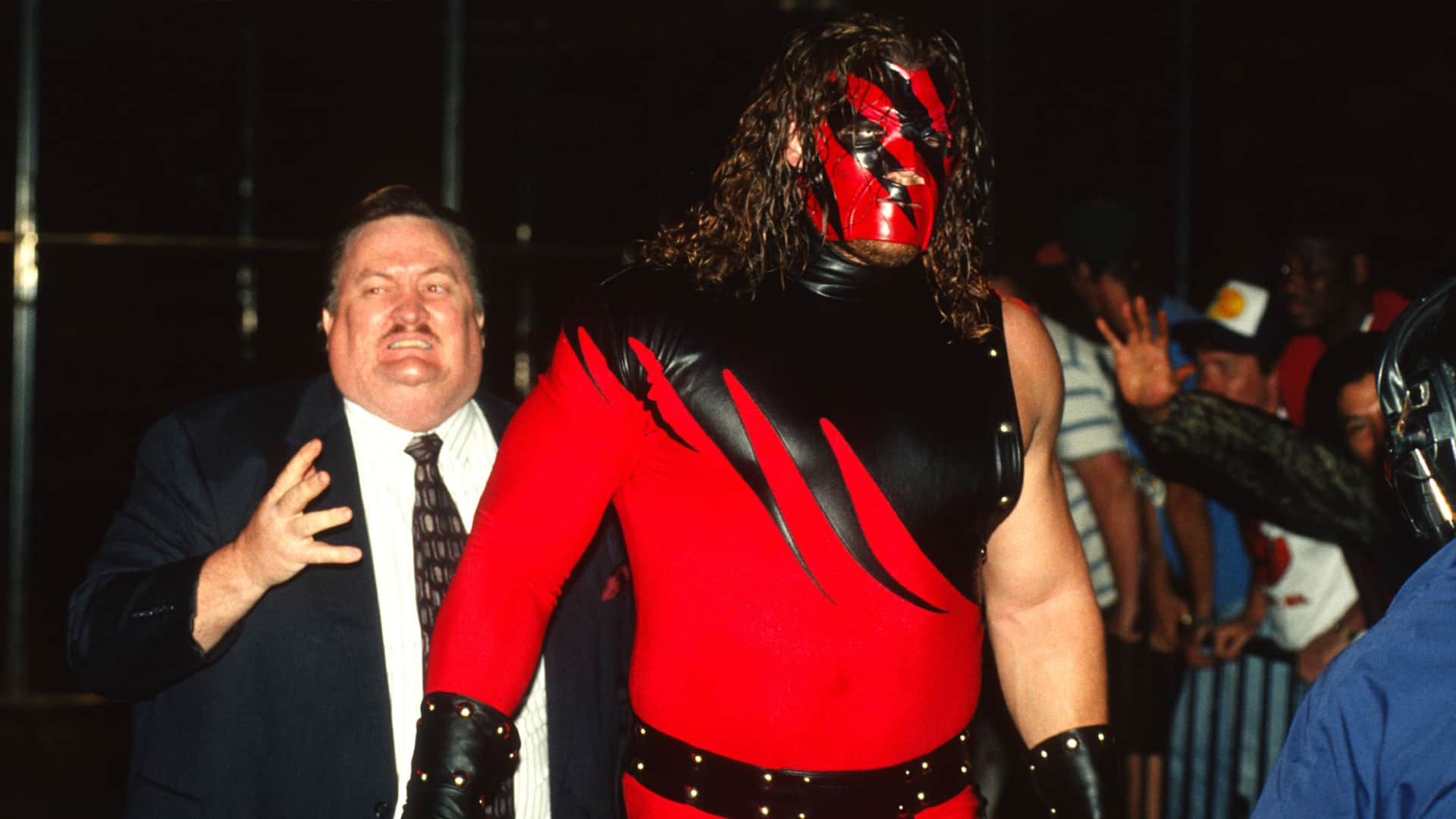 A masked Kane debuts with Paul Bearer by his side