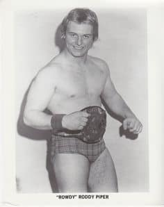 An old black and white photo of 'Rowdy' Roddy Piper when he was younger