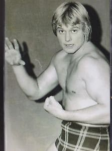 A black and white photo of 'Rowdy' Roddy Piper during his early days in professional wrestling