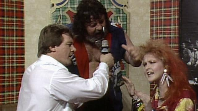 Roddy Piper, 'Captain' Lou Albano and Cyndi Lauper in a Piper's Pit segment in the lead-up to the inaugural WrestleMania.