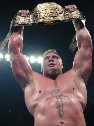 Brock Lesnar with the IWGP Heavyweight Championship