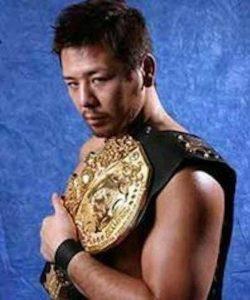 A young Shinsuke Nakamura with his IWGP Heavyweight Belt in 2003