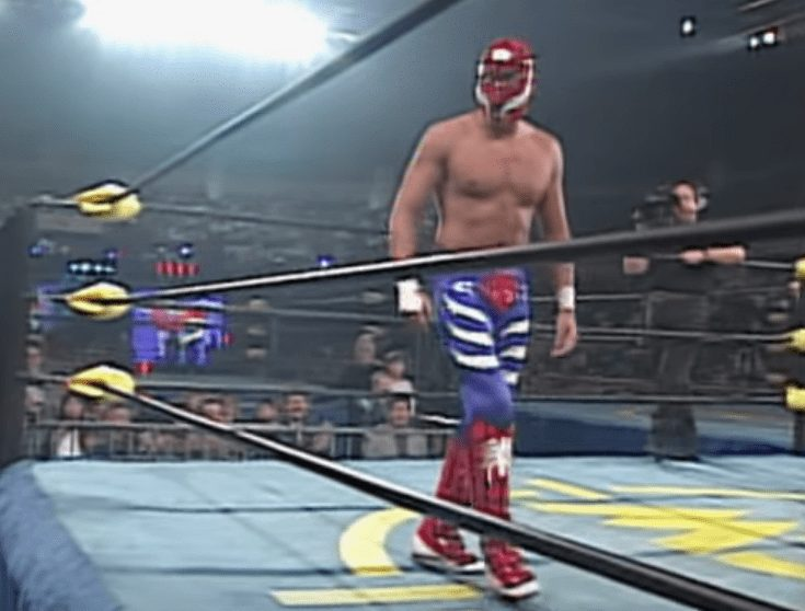Back in WCW during late 96/early 97, Rey Mysterio would fight under a red hood and blue tights. Various spider's placed around the suit and a black webbing design on the boots and mask made it obvious the color scheme was a conscious decision to look like Spiderman