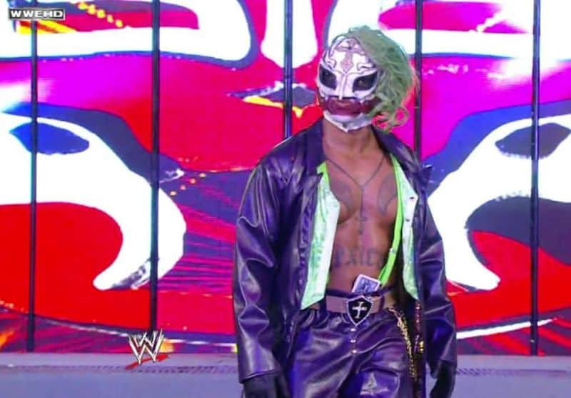 Rey Mysterio taking inspiration from the late, great Heath Ledger with his take on The Joker at WrestleMania 25. He wore purple trousers and entrance jacket, a green hairpiece and a white mask complete with and tactically place red wings and face make-up to accentuate the crown prince of crimes famous smile. In-ring, Rey took off the wig and coat to reveal bright green suspenders and even died green hair slightly visible from the back.