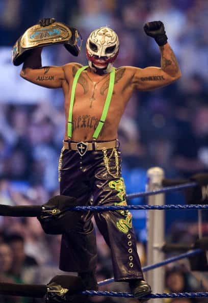 In-ring, Rey Mysterio, as The Joker, took off the wig and coat to reveal bright green suspenders and even died green hair slightly visible from the back. WrestleMania 25