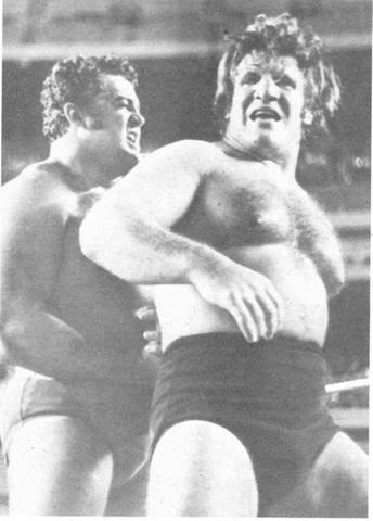 A black and white photo of Pedro Morales and Bruno Sammartino in the ring.