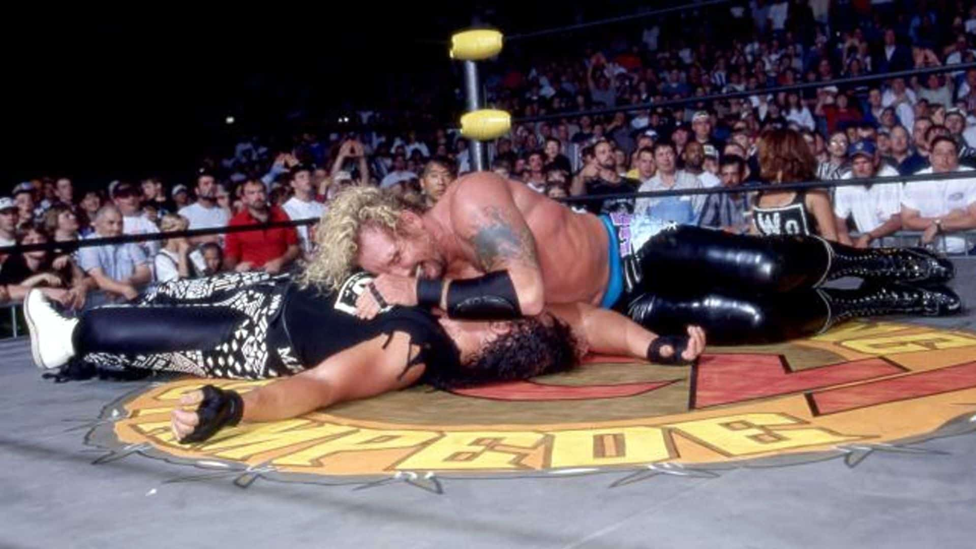 """DDP gets the 1-2-3 victory over """"Macho Man"""" Randy Savage at WCW's Spring Stampede pay-per-view, April 6, 1997."""