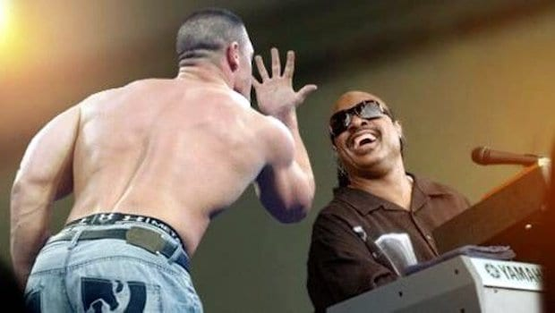 A photoshopped meme of John Cena holding up his hand to his face delivering his you can't see me catchphrase to Steve Wonder
