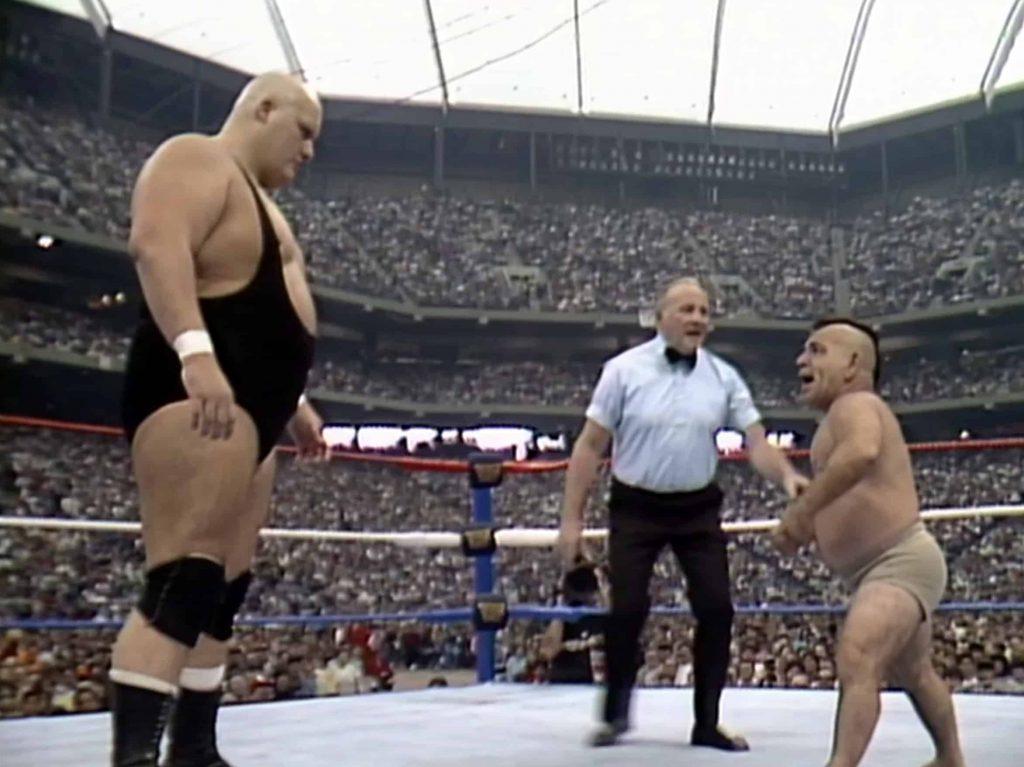 King Kong Bundy faces off against midget wrestler Little Beaver at WrestleMania 3