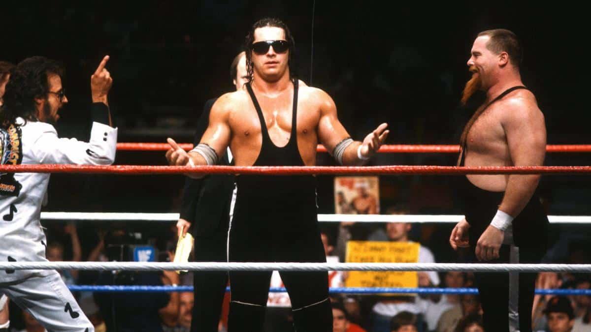 Bret Hart circa 1986 alongside Jimmy Hart and Jim 'The Anvil' Neidhart