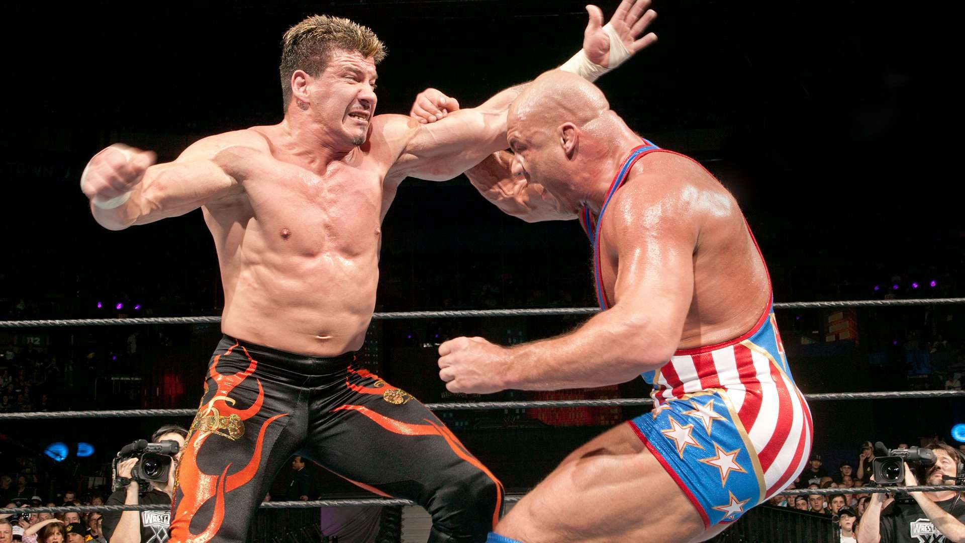 Eddie Guerrero and Kurt Angle, shown here in their 2004 WWE Championship match at WrestleMania XX, were like brothers outside of the ring. And like with brothers, things get a bit physical from time to time and in one instance backstage, the two of them got into it for real!