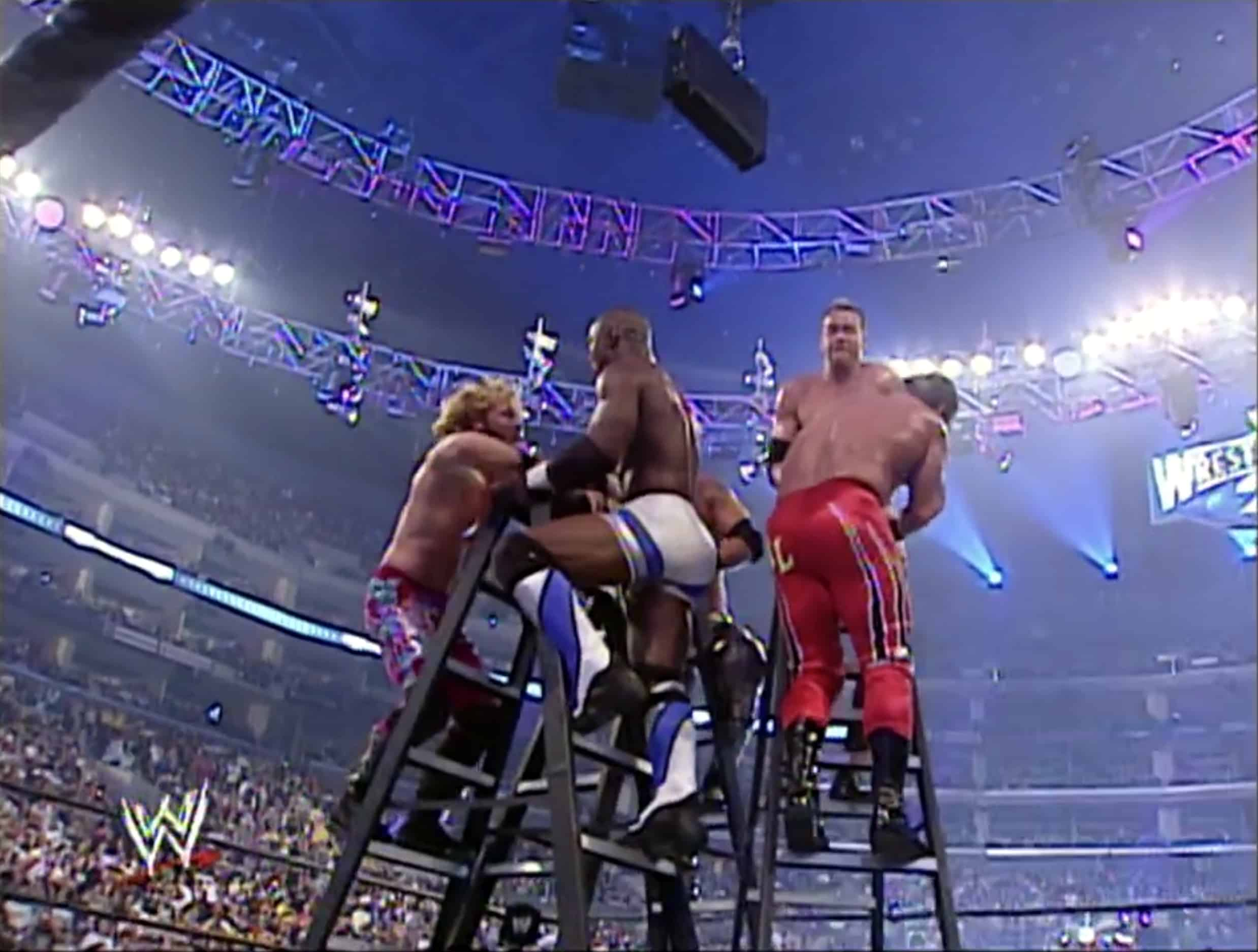 Chris Jericho, Shelton Benjamin, Edge, Christian, and Chris Jericho battle it out in the first-ever Money in the Bank Ladder match at WrestleMania 21, April 3, 2005.