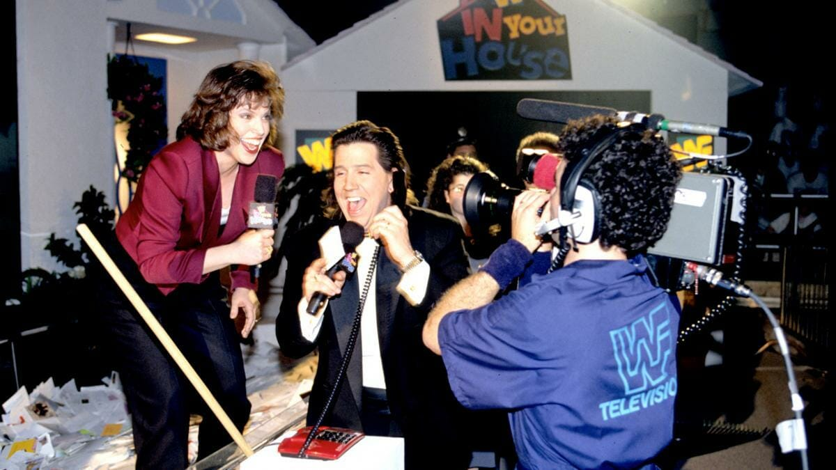 Todd Pettengill and Stephanie Wiand give away a house to a lucky fan during the inaugural In Your House pay-per-view.