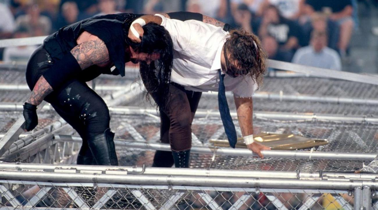 The Undertaker and Mankind fight it out on top of the Hell in a Cell cage at the King of the Ring pay-per-view on June 28, 1998.