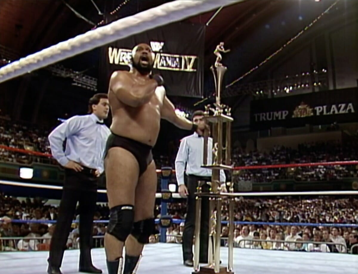 'I'm the winner!' Bad News Brown celebrates his battle royal victory at WrestleMania IV with his newly won trophy.