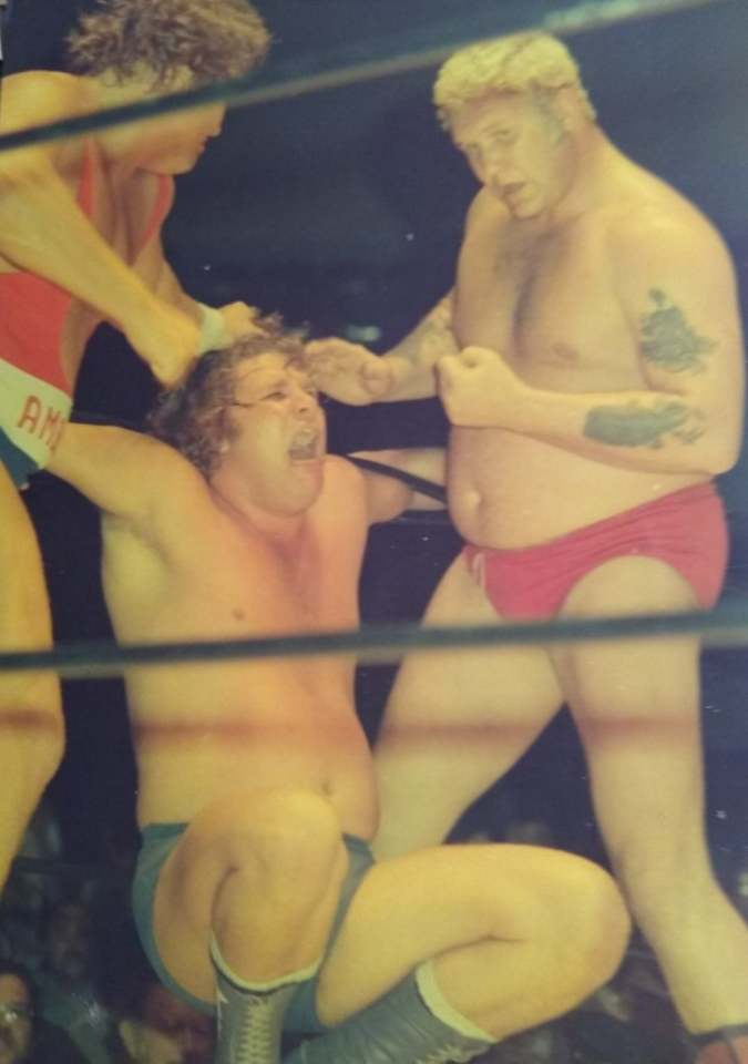 Bob Roop and Harley Race double-teaming Dick Slater.