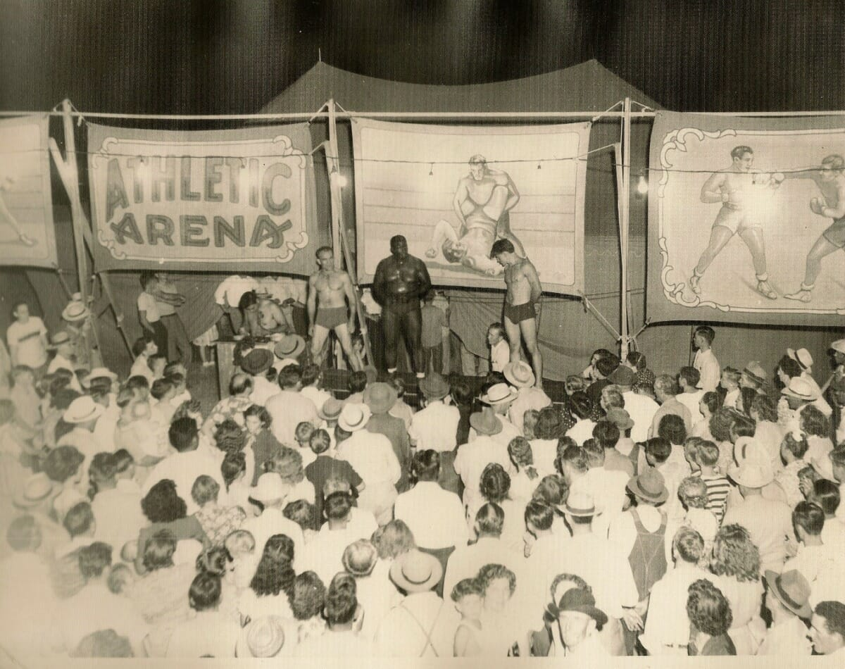 The crowd looks on as the wrestlers take on all comers at the AT show. These carnival attractions were most popular during the '30s and '40s.