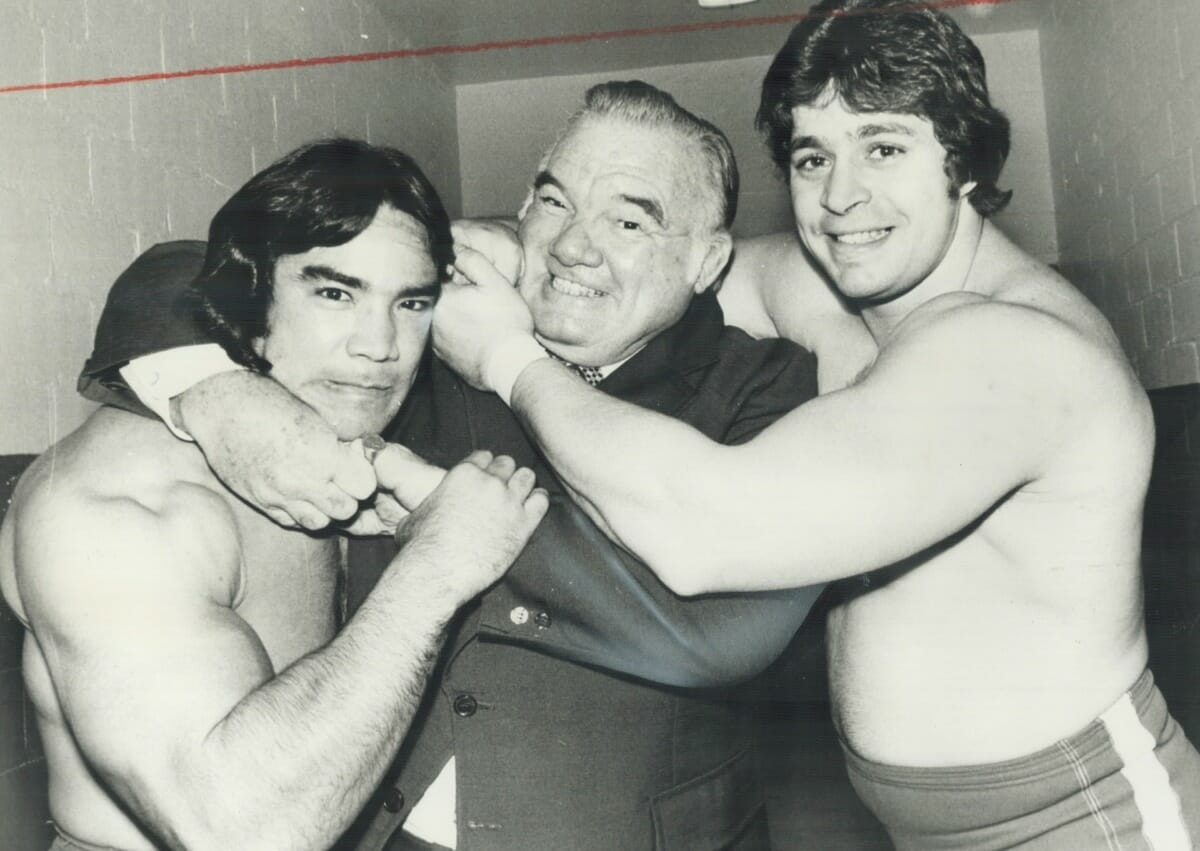 A young Ricky Steamboat, 'Whipper Billy Watson, and Dino Bravo clown around backstage at Maple Leaf Gardens in 1978.