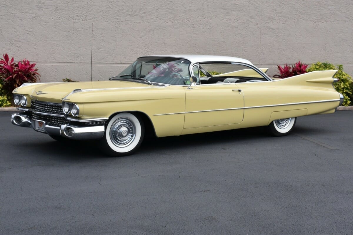 A yellow 1959 Cadillac Coupe Deville, exactly like the one Randy bought for our father Angelo on his 70th birthday.