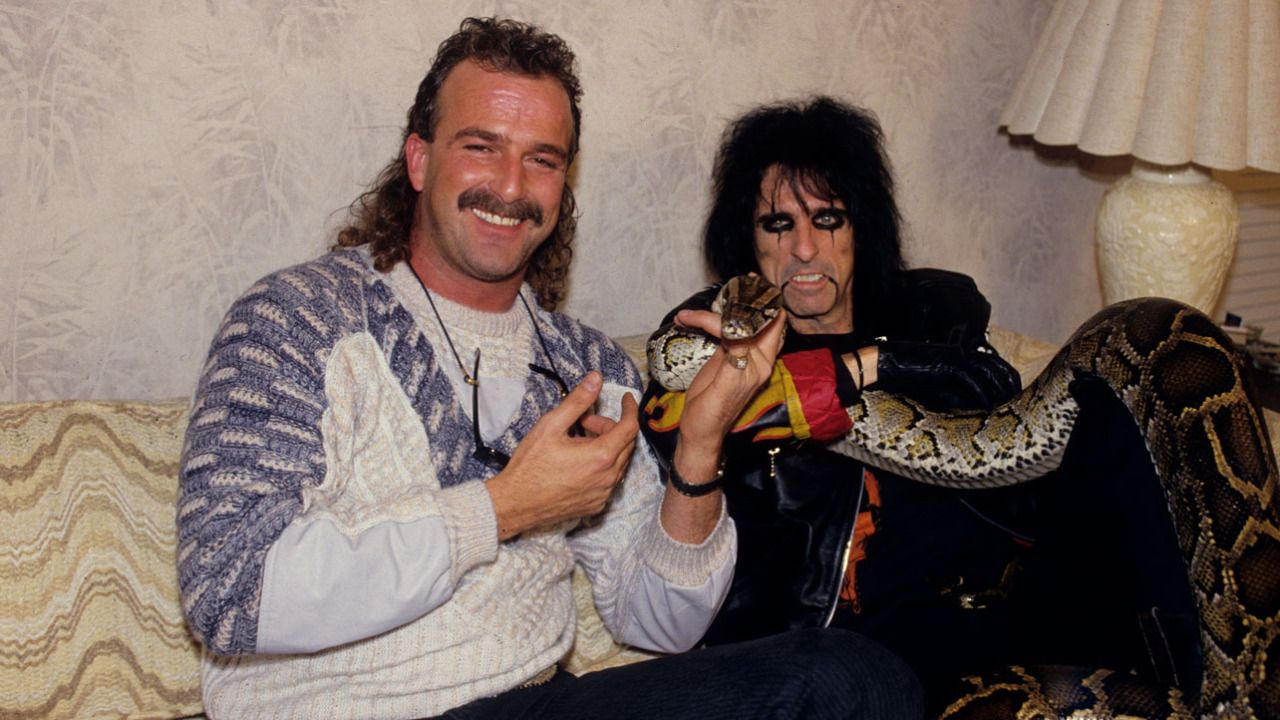 Jake Roberts and Alice Cooper spend some time together along with Damien the Snake at a New York City hotel.