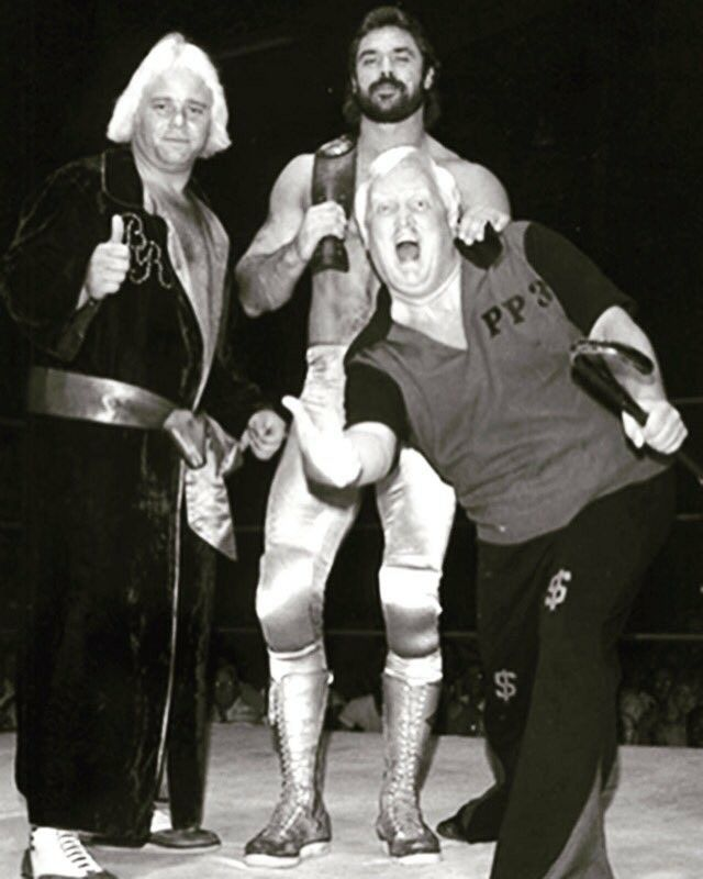 Buddy Rose, Rick Rude and Percy Pringle III (Paul Bearer) in Championship Wrestling from Florida in 1985.