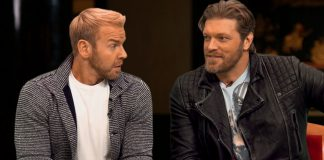 Edge and Christian sitting at a table talking