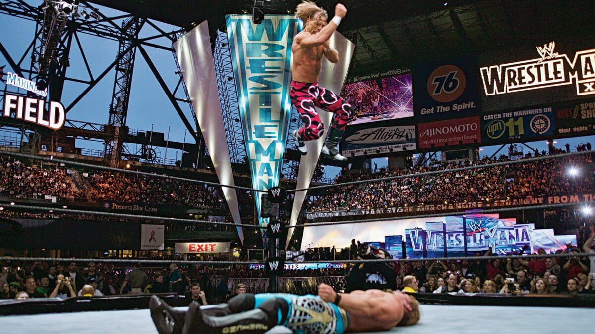 Shawn Michaels mid-flight against Chris Jericho at WrestleMania 19