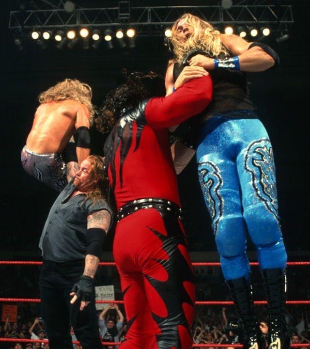 Undertaker and Kane choke-slamming Edge and Christian to Hell!