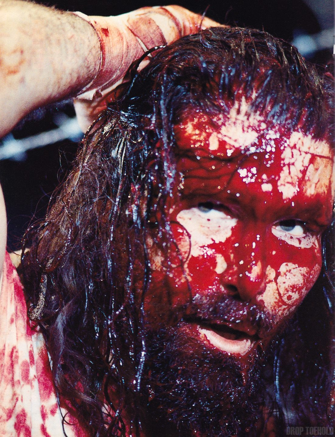 A bloodied Mick Foley (competing as Cactus Jack) in the aftermath of Japan's IWA Kawasaki Dream King of the Deathmatch final against Terry Funk on August 20th, 1995.