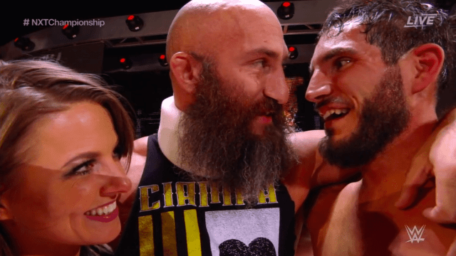 Candice LeRae, Tommaso Ciampa, and Johnny Gargano embrace at the culmination of April 5, 2019's NXT TakeOver- New York
