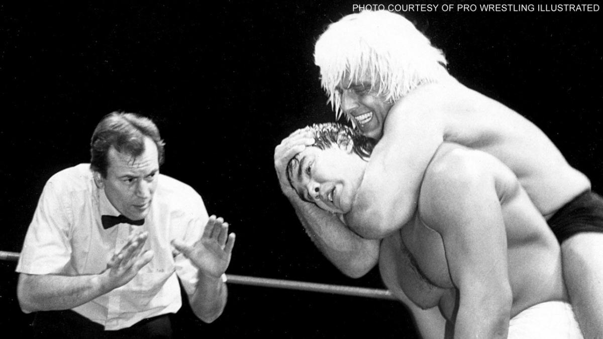 Ric Flair puts Ricky Steamboat in a sleeper hold with about seven minutes left in their match on April 2, 1989, at The Superdome in New Orleans, Louisiana.