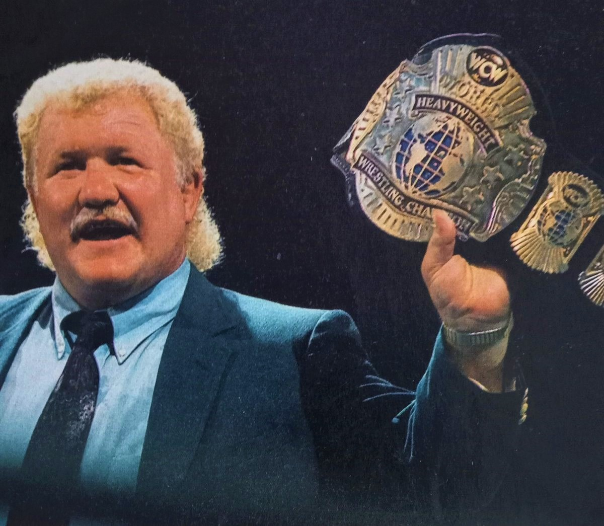 Harley Race seen here proudly holding the WCW World Championship belt who at the time was held by Big Van Vader. Vader would eventually hold it three times before leaving for WWE.