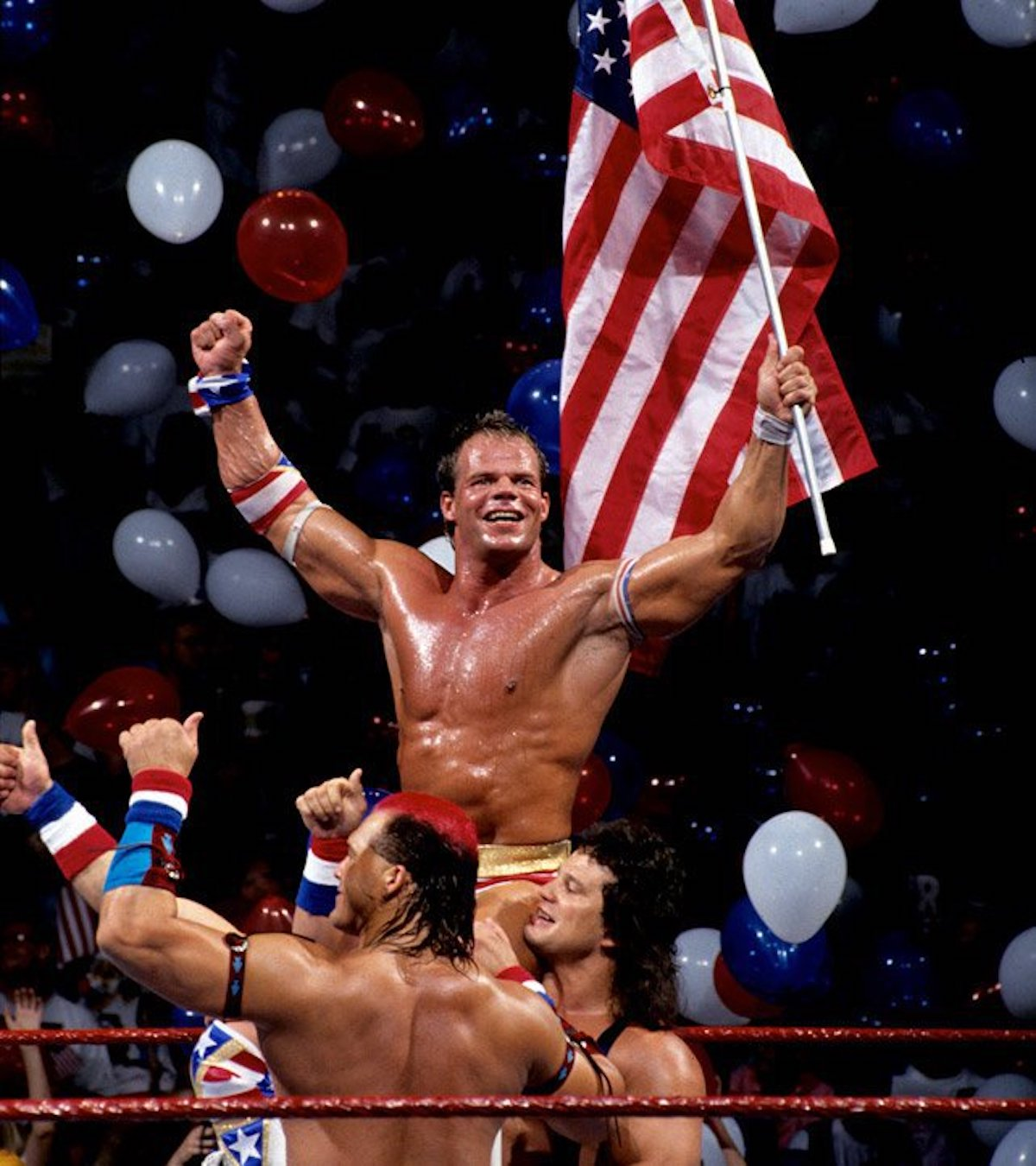 Lex Luger celebrates his countout victory over Yokozuna alongside fan favorites Tatanka and Scott Steiner at SummerSlam '93.