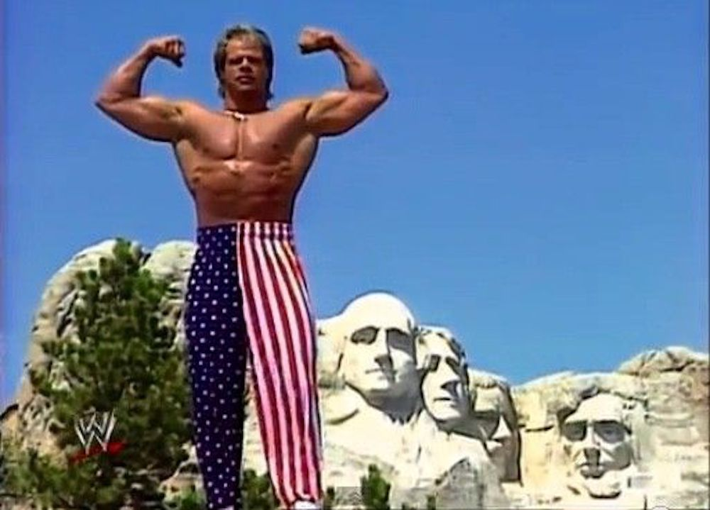 Lex Luger flexing his biceps at Mount Rushmore.