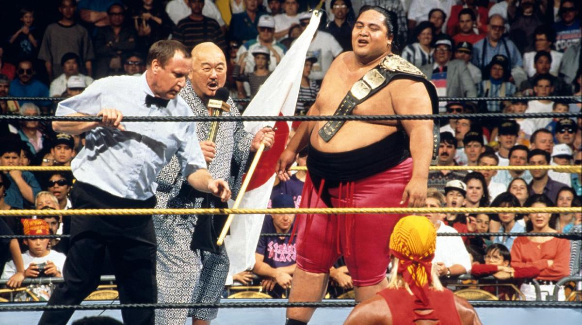 Rodney Anoa'i (Yokozuna) celebrates his first WWF championship win at WrestleMania 9. This moment would soon be overshadowed by the re-emergence of Hulk Hogan.