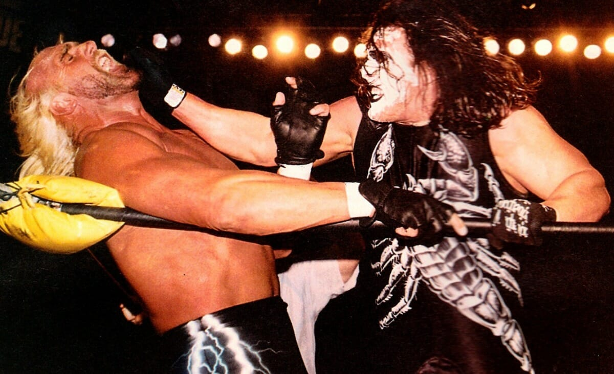 Sting attacks nWo member Hollywood Hulk Hogan at WCW Starrcade, December 28. 1997.
