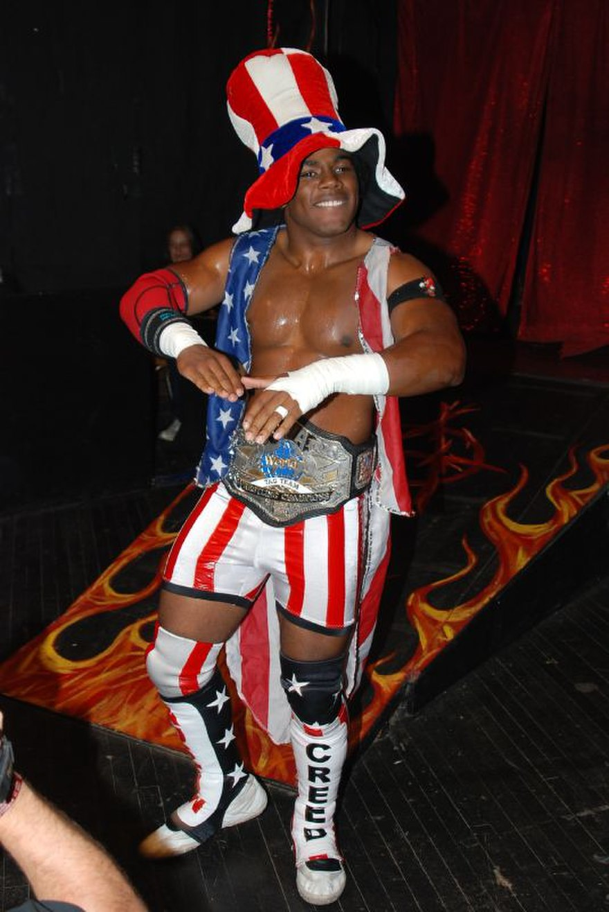 Xavier Woods worked in TNA using a Carl Weathers-inspired Consequences Creed gimmick.