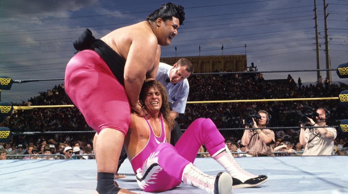 Rodney Anoa'i (Yokozuna) applies pressure to the shoulder of Bret Hart during the main event of WrestleMania 9.