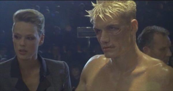 Bridgett Nelson as Ludmilla and Dolph Lundgren as Ivan Drago in Rocky.