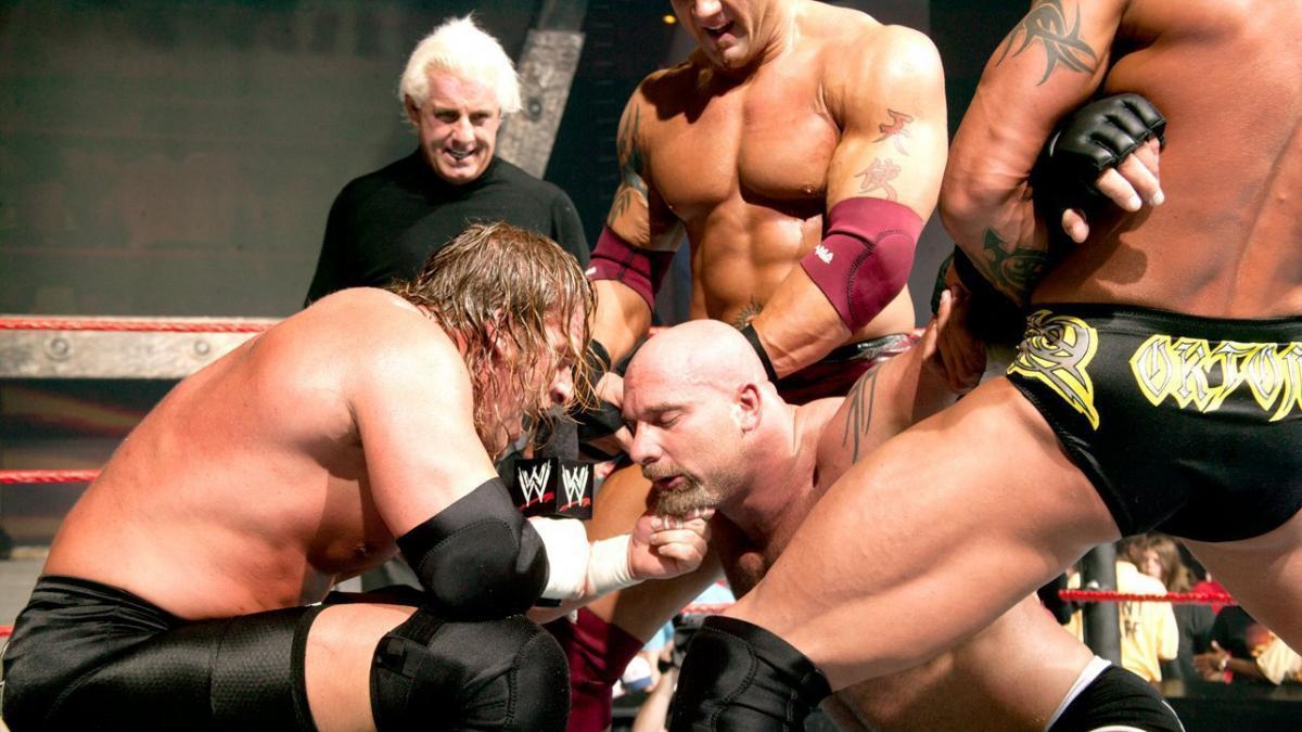 Triple H, Ric Flair, Bautista, and Randy Orton of Evolution team-up against Goldberg.