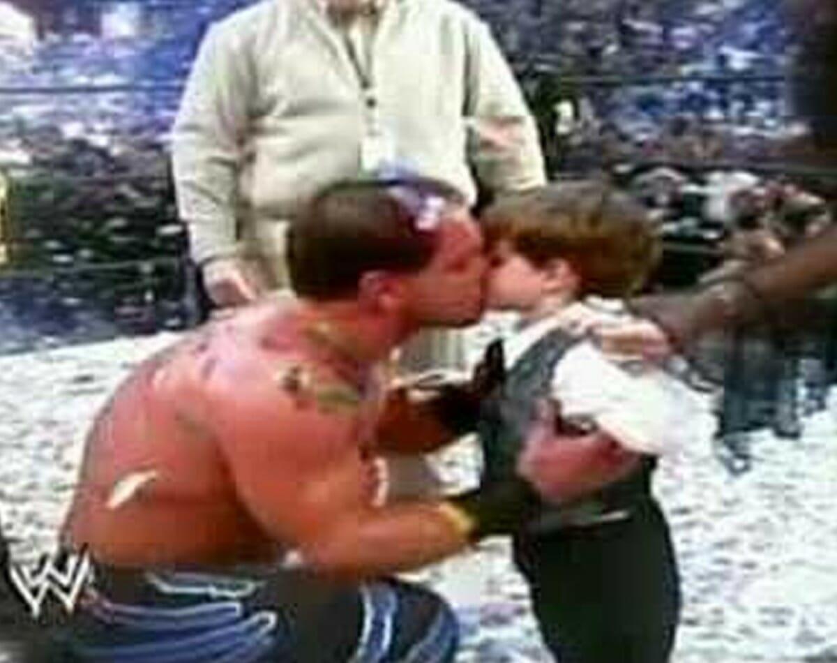 Chris Benoit kisses his son Daniel after winning the WWE World Heavyweight Championship at WrestleMania XX