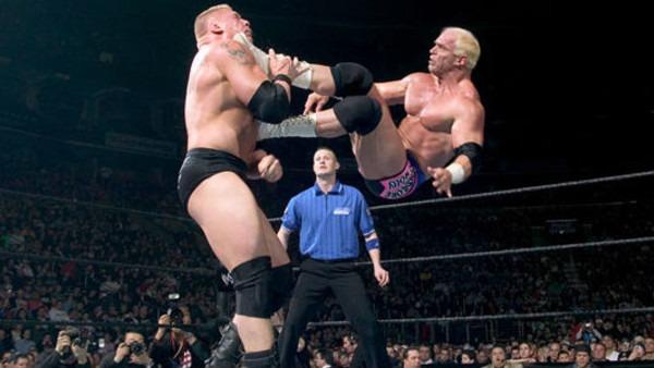 Bob Holly dropkicks Brock Lesnar.