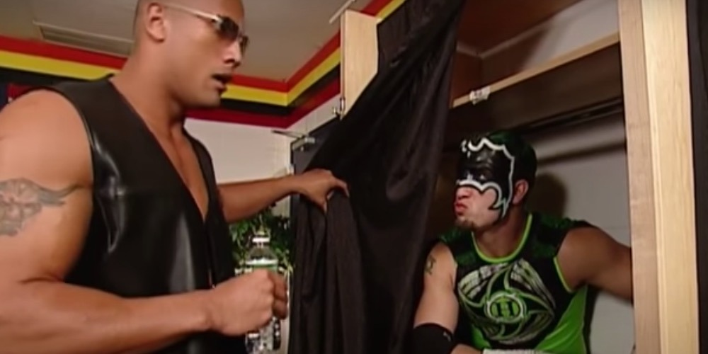 The Rock discovers The Hurricane lurking behind a curtain in his locker room. Hilarity ensued.