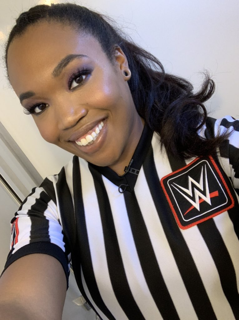 Aja Smith is the first full-time African American female referee for WWE.