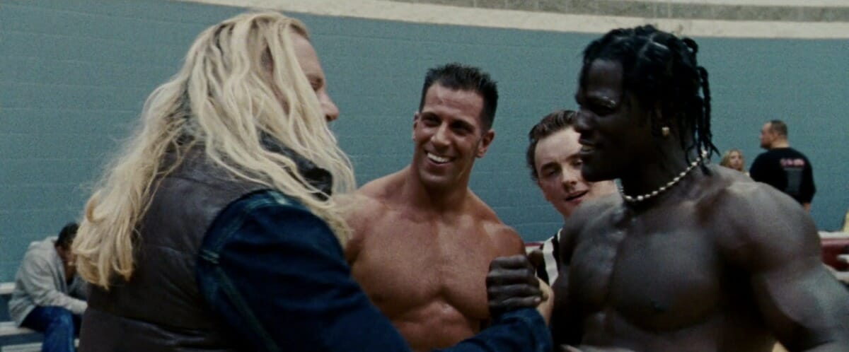Giovanni 'Romeo' Roselli, Ron 'R-Truth' Killings, and Mickey Rourke in The Wrestler.